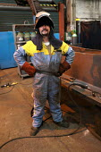 Welder, Engineering Workshop, Tata Steel Port Talbot, South Wales - Jess Hurd - 2010s,2016,EBF,Economic,Economy,employee,employees,Employment,Engineering Workshop,Eye Protection,FACTORIES,factory,hard hat,hard hats,hazard,hazardous,hazards,Health and Safety,INDUSTRY,job,jobs,LBR,