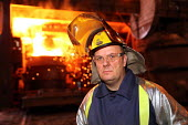 Steelworker, Tata Steel Port Talbot, South Wales - Jess Hurd - 2010s,2016,Basic Oxygen Steelmaking Converter,BOS,EBF,Economic,Economy,employee,employees,Employment,Eye Protection,FACTORIES,factory,flame,flames,FOUNDRIES,FOUNDRY,furnace,FURNACES,hard hat,hard hats