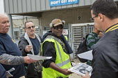 Hodgkins, Illinois, Teamster member Mike Prete (C) campaigning for Fred Zuckerman to be president of the Teamsters Union, UPS hub near Chicago. The Teamsters United slate are reformers who are opposin... - Jim West - 30-09-2016