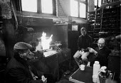 Occupation of L. Gardner and Sons Ltd engines factory, Eccles, Manchester against 590 compulsory redundancies. Workers keeping warm 1980 - John Harris - 20-11-1980