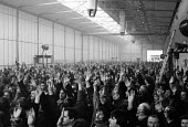 Mass meeting voting to return to work after winning. Occuaption of L. Gardner and Sons Ltd engines factory, Eccles, Manchester against 590 compulsory redundancies 1980 - John Harris - 1980,1980s,against,AUEW,CSEU,democracy,disputes,Eccles,ENGINE,engines,FACTORIES,factory,Hands up,Hawker Siddeley,INDUSTRIAL DISPUTE,job loss,Job Losses,jobs,L. Gardner and Sons,lock-out,loss,losses,ma