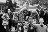 Youth with far right British Movement waving Union Jack and giving a Nazi salute, Coventry shopping precinct 1980 - John Harris - 29-04-1980