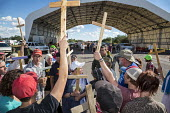 Tubac, Arizona, Immigration reform activists march through the Border Patrol checkpoint on Interstate 19, about 25 miles north of the USA Mexican border, where motorists are asked about their citizens... - Jim West - 09-10-2016