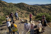 Bisbee, Arizona, USA, Christians put a cross in Mule Mountains near the spot where the remains of an unidentified migrant were found. Hundreds of migrants from Mexico and Central America have died cro... - Jim West - 2010s,2016,America,Arizona,BAME,BAMEs,Belief,Bisbee,BME,bmes,border,borders,bottle,bottles,Catholic,cemeteries,cemetery,christian,christianity,christians,circle,conviction,cross,crosses,crossing,cruci