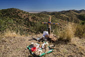 Bisbee, Arizona, USA, Christians put a cross in Mule Mountains near the spot where the remains of an unidentified migrant were found. Hundreds of migrants from Mexico and Central America have died cro... - Jim West - 2010s,2016,America,Arizona,BAME,BAMEs,Belief,Bisbee,BME,bmes,border,borders,bottle,bottles,Catholic,cemeteries,cemetery,christian,christianity,christians,conviction,cross,crosses,crossing,crucifix,cru