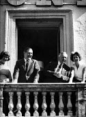Harold Wilson and James Callaghan with their wives on the balcony of the County Hotel, Durham Miners Gala 1963. Wilson became Leader of the Labour Party in preference to Callaghan earlier that same ye... - Romano Cagnoni - 20-07-1963