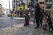 Berlin, Germany. Woman begging on a Berlin street corner - David Bacon - 2010s,2016,baggar,beg,beggar,beggars,BEGGER,begging,begs,Berlin,cities,city,destitute,Diaspora,dress,EBF,Economic,Economy,eu,Europe,european,europeans,eurozone,excluded,exclusion,FEMALE,foreign,foreig