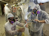 Wayne, Michigan, USA, Job Corps trainees learning how to safely remove asbestos, Michigan Laborers Training and Apprenticeship Institute. Job Corps is a free job training program for low income youth... - Jim West - 2010s,2011,America,asbestos,asbestos removal,ASBESTOSIS,Breathing Apparatus,career training,Caucasian,danger,dangerous,Department,DOL,duct tape,EDU,educate,educating,Education,educational,employee,emp