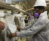 Wayne, Michigan, USA, Job Corps trainees learning how to safely remove asbestos, Michigan Laborers Training and Apprenticeship Institute. Job Corps is a free job training program for low income youth... - Jim West - 2010s,2011,African American,African Americans,African-American,America,asbestos,asbestos removal,ASBESTOSIS,BAME,BAMEs,black,BME,bmes,Breathing Apparatus,career training,danger,dangerous,Department,di
