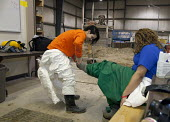 Wayne, Michigan, USA Job Corps trainees learning how to clean up hazardous materials at the Michigan Laborers Training and Apprenticeship Institute. Job Corps is a free job training program for low in... - Jim West - 2010s,2011,African American,African Americans,African-American,America,BAME,BAMEs,black,BME,bmes,career training,chemical,chemicals,cleanup,danger,dangerous,Department,diversity,DOL,EDU,educate,educat
