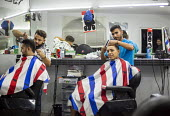 Nogales, Sonora, Mexico, customers having their hair cut at a Barber shop - Jim West - 2010s,2016,americas,barber,barber shop,barbers,cut,cutting,EARNINGS,EBF,Economic,Economy,employee,employees,Employment,hair,hair cut,Hair styling,Hair stylist,Hair stylists,haircut,haircutting,hairdre