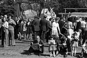 Durham Miners Gala, 1975. Annual procession of The Big Meeting through the City of Durham by miners from the pit villages of the north eastern area. Crowd gathers on Durham Racecourse waiting for spee... - John Sturrock - 19-07-1975