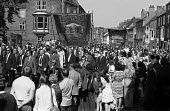 Durham Miners Gala, 1975. Annual procession of The Big Meeting through the City of Durham by miners from the pit villages of the north eastern area. Langley Park Lodge Banner on the Gala march. - John Sturrock - 19-07-1975