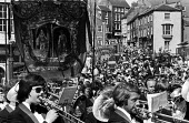 Durham Miners Gala, 1975. Annual procession of The Big Meeting through the City of Durham by miners from the pit villages of the north eastern area. Harton and Westoe Lodge Banner on the Gala march. - John Sturrock - 1970s,1975,ACE,band,bands,banner,banners,Big Meeting,Brass Band,cities,City,County Durham,Culture,Durham Gala,Durham Miners Gala,Gala,Harton and Weston,lodge banner,march,marching,Meeting,MEETINGS,mel