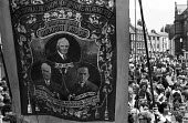 Durham Miners Gala, 1975. Annual procession of The Big Meeting through the City of Durham by miners from the pit villages of the north eastern area. Boldon Lodge Banner on the Gala march with Lord Law... - John Sturrock - 19-07-1975