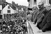 Durham Miners Gala, 1975. Annual procession of The Big Meeting through the City of Durham by miners from the pit villages of the north eastern area. Harold Wilson and James Callaghan watch the Gala fr... - John Sturrock - 1970s,1975,ACE,banner,banners,Big Meeting,cities,City,Culture,Durham Gala,Durham Miners Gala,Gala,Harold Wilson,James,James Callaghan,Jim Callaghan,Labour Party,lodge banner,march,marching,Meeting,MEE