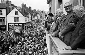 Durham Miners Gala, 1975. Annual procession of The Big Meeting through the City of Durham by miners from the pit villages of the north eastern area. Harold Wilson and James Callaghan watching the Gala... - John Sturrock - 17-07-1975