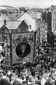 Durham Miners Gala, 1975. Annual procession of The Big Meeting through the City of Durham by miners from the pit villages of the north eastern area. Murton Lodge Banner at the Gala. - John Sturrock - 17-07-1975