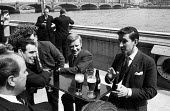 David Steel Liberal MP with fellow MPS on the Terrace at Parliament following his victory in the March 1965 bye-election. He was then the youngest Member of Parliament at The House of Commons known as... - Romano Cagnoni - 1960s,1965,alcohol,BABIES,Baby,bar,bars,beer,beer bottle,beer bottles,bottle,bottles,communicating,communication,conversation,conversations,David Steel,dialogue,discourse,discuss,discusses,discussing,