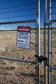 Mariano Lake, New Mexico, USA, Poisoned water for the Navajo. Sign warning of radiation danger on the site of an abandoned uranium mine, one of more than 500 abandoned mines on Navajo Nation land. Thi... - Jim West - 11-10-2016