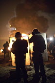 Police fire teargas into the Jungle refugee camp prior to demolition planned by French authorities, Calais, France - Jess Hurd - 23-10-2016