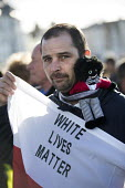 Man with golliwog on a racist White Lives Matter protest, Margate, Kent - Jess Hurd - 22-10-2016
