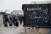 Refugees leaving The Jungle camp prior to a demolition planned by French authorities. Calais, France. Nobody is illegal - Jess Hurd - France,2010s,2016,African,Africans,BAME,BAMEs,Black,BME,bmes,Calais,camp,camps,clearing,closed,closing,closure,closures,DEMOLISH,DEMOLISHED,demolition,DEVELOPMENT,Diaspora,displaced,diversity,Eritrean