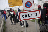 Refugees leaving The Jungle camp prior to a demolition planned by French authorities. Calais, France - Jess Hurd - France,2010s,2016,African,Africans,bag,bags,BAME,BAMEs,Black,BME,bmes,Calais,camp,camps,carries,carry,carrying,clearing,closed,closing,closure,closures,communicating,communication,DEMOLISH,DEMOLISHED,