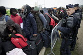 Calais, France. The Jungle. Refugees queuing to be registered for the reception centres prior to demolition of the camp by French authorities - Jess Hurd - France,2010s,2016,adolescence,adolescent,adolescents,African,Africans,bag,bags,boy,boys,Calais,camp,camps,child,children,clearing,CLJ,closed,closing,closure,closures,CRS,DEMOLISH,DEMOLISHED,demolition