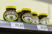 Jars of Marmite on a supermarket shelf - John Harris - 2010s,2016,bought,Brexit,buying,commodities,commodity,consumer,consumers,customer,customers,EBF,Economic,Economy,EU,European Union,eurosceptic,Euroscepticism,eurosceptics,food,FOODS,jar,jars,lack of,M