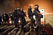 Riot police fire teargas into the makeshift Jungle camp prior to a demolition planned by French authorities. Calais, France. - Jess Hurd - 23-10-2016