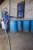 Thoreau, New Mexico, clean water being delivered by St. Bonaventure Indian Mission for a Navajo family. A third of the Navajo Nation lack a water supply in some places because past uranium mining has... - Jim West - 11-10-2016
