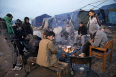 Afghan refugees in the makeshift Jungle camp prior to a demolition planned by French authorities. Calais, France. - Jess Hurd - 25-10-2016