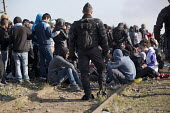 Refugees in the makeshift Jungle camp queue to be transfered to reception centres across France prior to a demolition planned by French authorities. Calais, France. - Jess Hurd - 25-10-2016