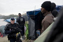 Fires rage during the eviction of refugees in the Jungle camp, Calais, France. - Jess Hurd - France,2010s,2016,adolescence,adolescent,adolescents,African,Africans,authorities,BAME,BAMEs,Black,BME,bmes,boy,boys,burn,burning,BURNS,Calais,camp,camps,child,children,CLJ,CRS,DEMOLISH,DEMOLISHED,dem