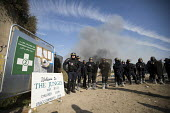 CRS police close the entrance, eviction of refugees from the Jungle camp, Calais, France - Jess Hurd - France,2010s,2016,adult,adults,authorities,BAME,BAMEs,Black,BME,bmes,body armour,Calais,camp,camps,CRS,DEMOLISH,DEMOLISHED,demolition,DEVELOPMENT,Diaspora,displaced,diversity,entrance,ethnic,ethnicity