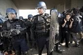 Police with CS gas genade launchers at the entrance to The Jungle camp, eviction of refugees, Calais, France - Jess Hurd - 26-10-2016