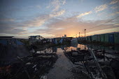 Apocalyptic remains of the Calais Jungle refugee camp after fires rage during the eviction by French authorities, France. - Jess Hurd - 26-10-2016