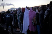Refugees queuing at dawn for buses outside the reception centre only to be refused, The Jungle camp eviction, Calais, France - Jess Hurd - France,2010s,2016,adolescence,adolescent,adolescents,African,Africans,authorities,BAME,BAMEs,Black,BME,bmes,border,Border and Immigration Agency,border control,border controls,borders,boy,boys,BUS,bus