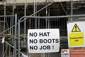 Health and safety notice at a building site entrance: No Hat, No Boots, No Job! Leamington Spa, Warwickshire - John Harris - 2010s,2016,Boots,bricklayer,bricklayers,bricklaying,Brownfield Site,builder,builders,building,building site,Building Worker,buildings,communicating,communication,Construction Industry,danger,DANGEROUS