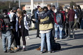 Volunteers receive hugs from child refugees leaving the Jungle camp, Calais, France. - Jess Hurd - 2010s,2016,African,Africans,agencies,agency,aid,authorities,BAME,BAMEs,Black,BME,bmes,Calais,camp,camps,Care4Calais,charitable,charities,charity,child,CHILDHOOD,children,closed,closing,closure,closure