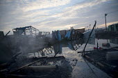 Burnt out remains after the eviction of refugees from the Jungle camp, Calais, France - Jess Hurd - 26-10-2016
