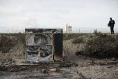 Burnt out remains after the eviction of refugees from the Jungle camp, Calais, France - Jess Hurd - 2010s,2016,BAME,BAMEs,Black,BME,bmes,Burnt,burnt out,Calais,camp,camps,charred,CLJ,CRS,destroyed,destroying,destruction,Diaspora,displaced,diversity,down,ethnic,ethnicity,eu,Europe,european,europeans,
