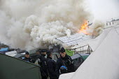 Fires rage during the eviction of refugees from The Jungle camp, Calais, France - Jess Hurd - 26-10-2016