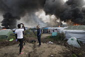 Fires rage during the eviction of refugees in the Jungle camp, Calais, France. - Jess Hurd - 2010s,2016,African,Africans,authorities,BAME,BAMEs,Black,BME,bmes,burn,burning,BURNS,Calais,camp,camps,DEMOLISH,DEMOLISHED,demolition,DEVELOPMENT,Diaspora,displaced,diversity,Eritrean,Eritreans,ethnic