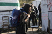 Refugees forced to leave the makeshift Jungle camp by riot police during the eviction. Calais, France. - Jess Hurd - 25-10-2016