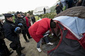 Immigration Officers and Police searching tents, eviction of refugees in the Jungle camp, Calais, France - Jess Hurd - 26-10-2016