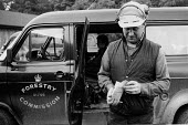 Forestry worker collecting his pay packet, Kielder Forest, Northumberland 1985 - Denis Doran - 22-01-1985