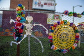 Oakland, California, USA, Mexican festival of the Dia de los Muertos or Day of the Dead, Latino Fruitvale District, Eastside Cultural Center. Altars to remember relatives, friends or others who have d... - David Bacon - 02-11-2016