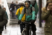 Deliveroo cyclist delivering, Coventry Precinct - John Harris - 2010s,2016,bicycle,bicycles,BICYCLING,Bicyclist,Bicyclists,BIKE,BIKES,cities,City,City centre,contracts,cycle,cycles,cycling,Cyclist,Cyclists,deliveries,delivering,delivery,EARNINGS,EBF,Economic,Econo